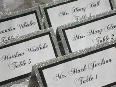 "If I decide to do placecards..I love the design: on our ""address labels"", stuck on black paper, glitter paper (no ""tent glitter"" paper)"