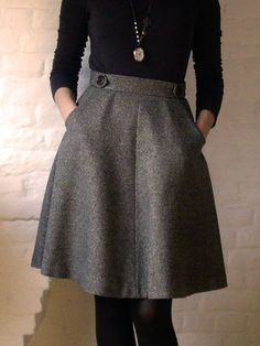 gray aline (wool) + black top + sheer tights + boots + hair up