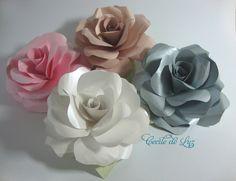 Exuberantes rosas em papel metálico perolado importado, com 3 folhas em verde claro. Usos diversos: Em bouquets, arranjos, decoração de vitrines, enfeites de presentes, porta guardanapos etc..  Cores disponíveis - Rosa, Nude, Branca e Prata. - 9,5 a 10 cm de diâmetro - Peso aproximado de 15 gramas - Consulte preços para pedidos acima de 100 unidades ATENÇÃO: Pedido mínimo de 10 unidades R$ 7,00
