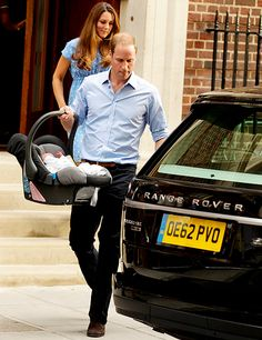 Prince William and baby Cambridge...normal for most dads, but I love that he is carrying the car seat out himself!