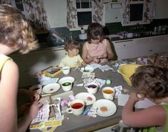 Lady Jacqueline Kennedy, John F. Kennedy, Jr., and two unidentified people painting Easter eggs in April 1963. (Palm Beach, Florida)