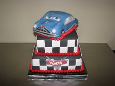 The little boy wanted Doc Hudson on top instead of lightening McQueen so I made him out of Rice Krispy Treats. The cake is covered in fonda...
