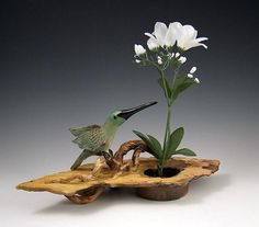 Ship Date: 2-4 weeks Ikebana vase, carved clay slab with sculpted branches and Hummingbird. Air brushed and smoke fired finish. Water cup with pin frog to hold
