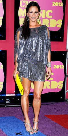 SARA EVANS - gets glitzy in a Julian Joyce Made by Mandalay silver sequined dress with slashes along the sleeves.