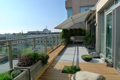 balcony garden with a great fabric awning for shade