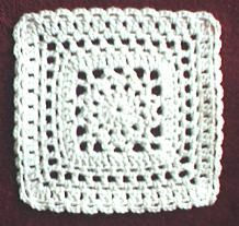 "Lace Medallion 8"" Square http://web.archive.org/web/20040227110426/http://members.aol.com/crochetalong/lacemedsq.html"