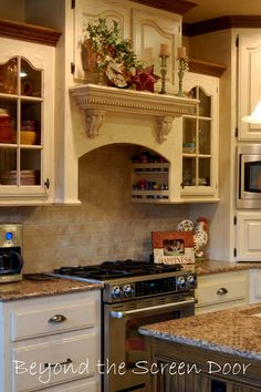 French Country Kitchen design ideas and decor, Love the above stove cabinets with spice storage!