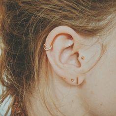 Ear piercings (helix + tragus +double lobe) by1oak.