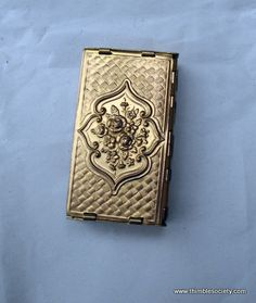 Folding 'Avery' Brass Needle Case; unfolds like a miniature concertina, with space for 5 needle packets when unfolded; Circa 1870