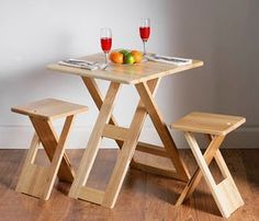 folding table and folding stools. small house, small home, tiny house, tiny home, small spaces, small space living, space-saving, compact, folding, furniture, seating, table, chair, chairs