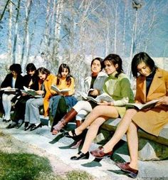 Iranian women, before the Islamic Revolution of 1979. Books, modern appearance,  and smiling confidence.