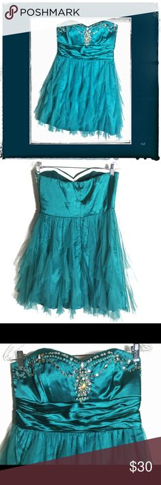 SALE Womens Turquoise Jewel GemStone Prom Dress Turquoise Jeweled Prom Dress Size juniors 11/12. It has been worn one time & is still in very good condition. Very beautiful & Eye catching.///Check out my other listings for more one of a kind Handmade & Vintage Treasures! If you like the item,not the price, place an offer! To bundle,select each item you want,click add to bundle,then you can go to your bundles & purchase/place an offer for the bundle! Macy's Dresses