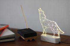 He encontrado este interesante anuncio de Etsy en https://www.etsy.com/es/listing/209546817/concreto-moderno-howling-wolf-lampara