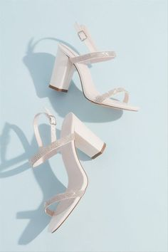 White block heels for wedding - David's Bridal two-tone glitter block heels in white, $60, David's Bridal - Check out more summer sandals on WeddingWire!
