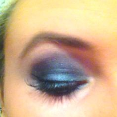 Smokey black eye with hints of green and purple.