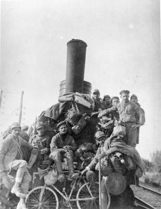 ITALIAN SOLDIERS ITALIAN FRONT 1917 (Q 114386) The Great Italian retreat. Italian troops riding on a railway engine during the retreat.