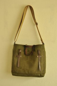 Waxed canvas tote leather accessories military green messenger bag handbag shoulder bag mustard cotton straps. $85.00, via Etsy.