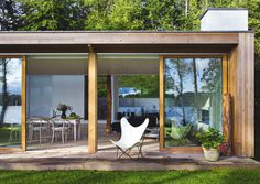 a danish summer home by architect Mette Lange Tiny House Cabin, My House, Timber Sliding Doors, Sliding Windows, Decks, Danish House, Indoor Outdoor Living, Prefab, Building A House