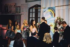 Addicted to the watercolor trend? This modern backdrop made a fantastic decoration for this bride and groom's modern wedding ceremony. Later, it can be used as a backdrop for pictures or even hung in the couple's home.