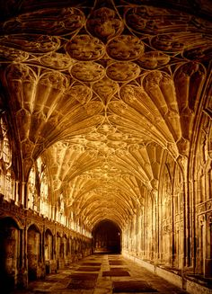 Gloucester Cathedral cloisters. 678-679, an abbey dedicated to St. Peter. 1089, foundation stone laid. 1541, refounded  as cathedral by Henry VIII. 2000, used as location for Harry Potter, in first, second and sixth films. 2008, location for Dr. Who Christmas Special.