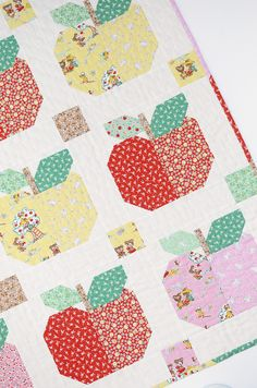 Sweet Apples Baby Quilt and Pillow Pattern by ellis & higgs made with Elea Lutz's Apple Farm collection for Penny Rose Fabrics.