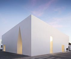 lisbon-based architecture studio aires mateus has completed a monolithic white structure that serves as a community meeting center.