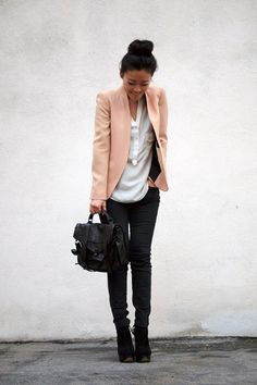 Fair colored blazer paired with black pants. Nice..