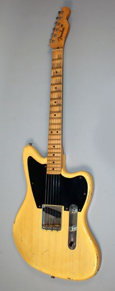 """Fender Custom Shop Telemaster. This is probably one of the most creative ideas in a long time. Fender has only officially made these for big vendors like Make n Music, but the design has caught on with custom builders as well. Why hasn't fender officially introduced this via their """"pawnshop"""" or """"road worn"""" series? they are really missing the boat on a high demand item."""