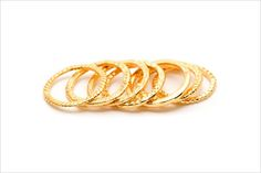 Gorgeous gold stackable rings by Gorjana.