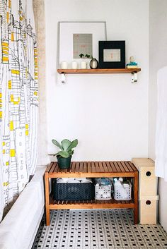 This bench is an attractive and practical solution for bathroom storage. Plus, a tip: Don't relegate your plants to the living or bedrooms. They're just as bright in the bathroom, but more convenient to water.