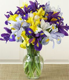 iris bouquet...For our wedding, I had a bouquet of Iris' in mostly white with a touch of purple/yellow (our wedding colors)