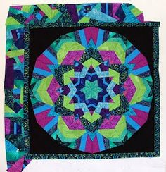 I like the reflected border on this mandala quilt