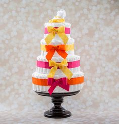http://www.genderneutralbabyclothes.com/category/pampers-swaddlers-size-2/ Baby Girl Diaper Cake - Savannah