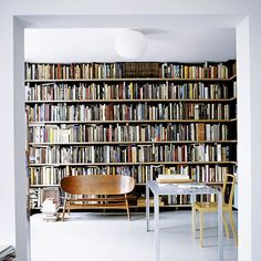 Nice shelves but need more comfy seating (Hans Wegner bench aside). Amsterdam home of architect Moriko Kira. Photo by Christian Richters