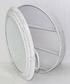 $34.99 tall of these in the kids bath rather than one big mirror? Could do fun nautical theme!! :-) White Metal Porthole Mirror Cabinet on #zulily! #zulilyfinds