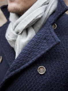 Brrr! It's cold outside! Time to bundle up the best way we know how--w/ a scarf! We love the chic yet simple look of this men's coat and knotted scarf.