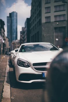 "Frankfurt is a powerhouse of a city, a nucleus of vertiginous skyscrapers earning it the local nickname ""Mainhattan"", after the adjacent Main River. Join the Mercedes-Benz SLC on a roadtrip through the city of Frankfurt, Germany. Photo via Mercedes-Benz Deutschland."