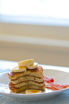 Paleo banana pancakes  1 1/4 cup blanched almond flour 1/4 cup coconut flour 1/2 teaspoon baking soda 1/4 teaspoon celtic sea salt 1 cup full fat coconut milk 1 ripe banana, mashed (about 1/2 cup) 3 large eggs 1 teaspoon vanilla extract 1 tablespoon raw honey (optional) coconut oil, ghee or butter for frying maple syrup and fruit for topping (optional)