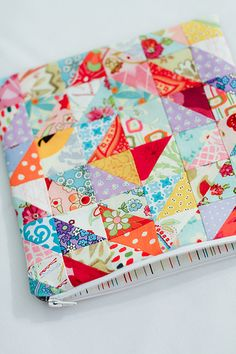 Patchwork Zippy Pouch by Jeni Baker. Each square about 1.75 in. Bag about 9 in. square. Used fusible fleece.