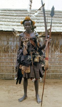 Africa | Extensive regalia worn by titled Kuba soldier known as Iyol, Bungamba village, DR Congo | ©Eliot Elisofon. 1970