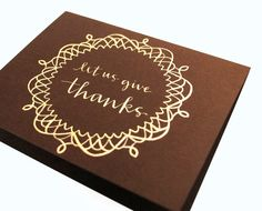 Thanksgiving Greeting Card . Doily with Handwritten Calligraphy . Let Us Give Thanks . Gold Ink on Dark Brown .