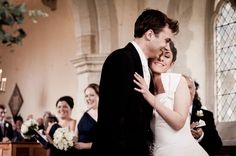 Beautiful little moment just after the first kiss during a traditional church wedding in Oxfordshire