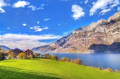 This HD wallpaper is about brown painted house with green grass field near calm body of water with mountain as background under the blue sky, Original wallpaper dimensions is file size is Blue Sky Wallpaper, Scenic Wallpaper, Landscape Wallpaper, Nature Wallpaper, Girl Wallpaper, Iphone Wallpaper, Switzerland Wallpaper, 4k Ultra Hd Wallpapers, Desktop Wallpapers