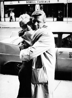 New York, 1961: Audrey receives a hug from co star and great friend George Peppard on the set of Breakfast At Tiffany's.