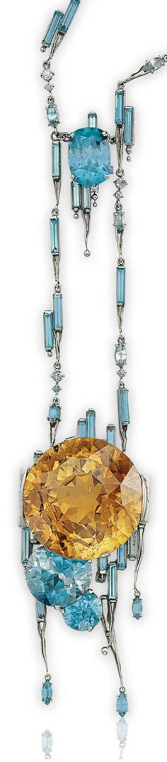 LOUIS COMFORT TIFFANY, TIFFANY & CO. - AN UNUSUAL MULTI-COLORED ZIRCON AND PLATINUM NECKLACE, CIRCA 1920. Suspending a circular-cut orange-brown zircon, enhanced by two circular-cut blue zircons set in an overlapping motif, accented by baguette-cut blue zircons, extending sculpted platinum and navette cabochon zircon terminals, to the neckchain of similar design, 19 ins., mounted in platinum. Signed Tiffany & Co. #LouisComfortTiffany