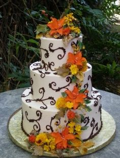 Great idea for Fall wedding cake.  Love the simple brown design on the cake icing and the fall flowers add enough color but not too much.  #wedding , #cakes
