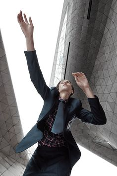 WALLPAPER & DIOR Men editorial shooting in the Guangzhou Opera house designed by Zaha Hadid