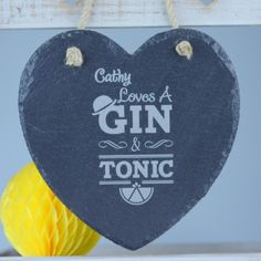 Gin And Tonic Personalised Slate Heart - £17.95. Chalk up a very different kind of bar slate with a quality heart dedicated to the art of gin and tonic drinking. With a shape that you can't help but fall in love with and hanging rope included, displaying your preference for this tasty tipple has suddenly become a home décor enhancer. Gin is very much the drink of the moment, with premium options meaning that we can all become connoisseurs of the drink formerly known as 'Mother's Ruin'.