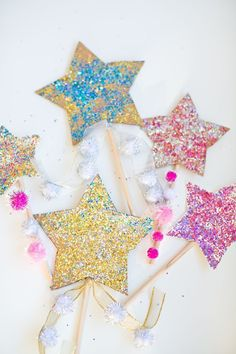 DIY Glitter Star Wands. Make these easy wands from cardboard to celebrate new year's or any fun celebration!