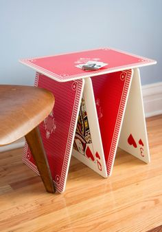 This compact playing card side table will definitely be the big winner in any room! Playful and bold in color, it's great to use or simply keep as a decorative conversation piece. Don't have to use it anymore? It's fully stackable and does not need much storage space.